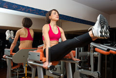 Woman workout in gym Royalty Free Stock Images