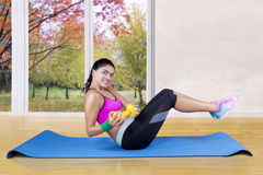 Woman workout at home in autumn season Stock Image