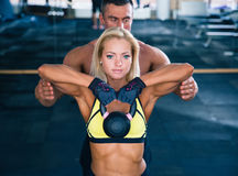 Woman workout with kettle ball in gym Stock Photography