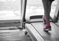 Woman workout on treadmil split-tone Royalty Free Stock Image