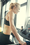 Woman workout on treadmill, side view Stock Photo