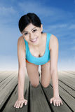 Woman workout on the wooden floor Royalty Free Stock Photography