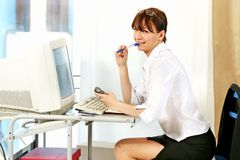 Woman at workplace Stock Photos