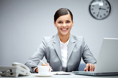 Woman at workplace Stock Photography