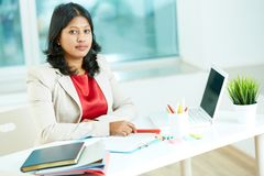 Woman at workplace Stock Image