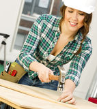 Woman Works on a Bench Building Something Stock Photos