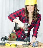 Woman Works on a Bench Repairing A Dolly Stock Photography