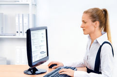 Woman works at the computer Royalty Free Stock Images