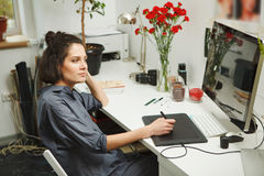 Woman works at computer, analysis and draws in freehand Stock Photography