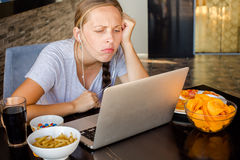 Woman works at the computer and eating fast food. Unhealthy Life Stock Photos