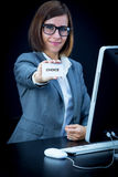 Woman works at the computer and showing a card with text Royalty Free Stock Image