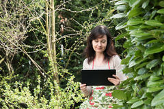 Woman works in garden Royalty Free Stock Photography