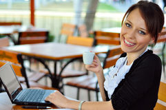 Woman works having a cup of coffee Stock Photography
