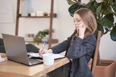 Woman works at home or in a business incubator. freelancing concept. relaxed in the workplace.  stock images