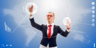 Woman works with the interface of the future. Blonde businesswoman wearing red tie and glasses works with the interface of the future, world map here it is Stock Photo