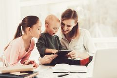 A Woman Works During Maternity Leave At Home. Family Relationship Concept. Gadget Screen. Little Hands. Active Family. Holiday Leisure. Happy Childhood. Parent royalty free stock photography