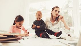 A Woman Works During Maternity Leave At Home. Problems Solving. Official Clothes. Comfortable Environment. Talking On The Phone. Concentrated Worker. Parent royalty free stock images