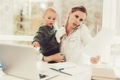 A Woman Works During Maternity Leave At Home. Problems Solving. Official Clothes. Comfortable Environment. Talking On The Phone. Concentrated Worker. Parent stock photos