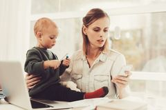 A Woman Works During Maternity Leave At Home. Problems Solving. Official Clothes. Comfortable Environment. Talking On The Phone. Concentrated Worker. Parent stock images