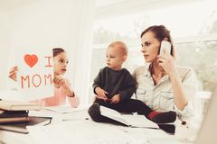 A Woman Works During Maternity Leave At Home. Problems Solving. Official Clothes. Daughter`s Paint. Talking On The Phone. Concentrated Worker. Parent Duty stock image