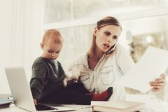 A Woman Works During Maternity Leave At Home. Problems Solving. Official Clothes. Comfortable Environment. Talking On The Phone. Concentrated Worker. Parent royalty free stock image