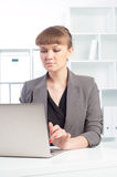 Woman works in the office Royalty Free Stock Photography