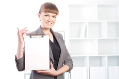 Woman works in the office Stock Images