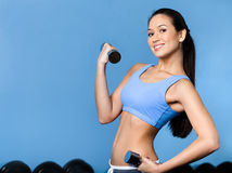 Woman works out with dumbbells Stock Images