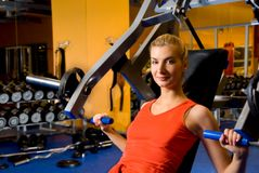 Woman works out in a gym Stock Photo