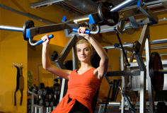 Woman works out in a gym Royalty Free Stock Photos