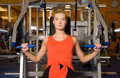 Woman works out in a gym Royalty Free Stock Photo