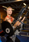 Woman works out in a gym Stock Image