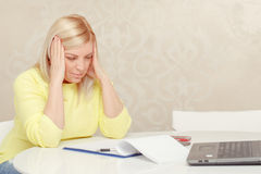 Woman works with papers at home royalty free stock images
