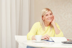 Woman works with papers at home Stock Photo