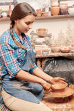Woman works on pottery wheel Royalty Free Stock Photo