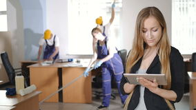 A woman works on the tablet. stock footage
