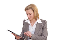 Woman works with a tablet pc Stock Photography