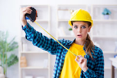 The woman in workshop with measuring tape. Woman in workshop with measuring tape Royalty Free Stock Images
