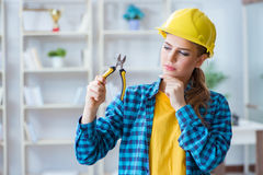 The woman in workshop with pliers. Woman in workshop with pliers Stock Images
