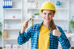 The woman in workshop with pliers. Woman in workshop with pliers Stock Photos