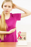 Woman and world breast cancer day on calendar Stock Image