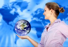 Woman with the world in her hands Stock Photos