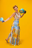 Woman with a world map and globes Royalty Free Stock Image