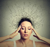 Woman worried stressed eyes closed trying to concentrate brain melting into lines. Closeup young woman with worried stressed face expression eyes closed trying Royalty Free Stock Photography