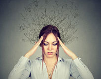 Woman with worried stressed face expression brain melting into lines Royalty Free Stock Image