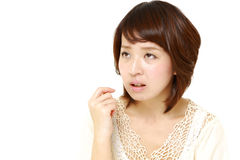 Woman worries about something. Concept shot of Japanese woman's lifestyle Royalty Free Stock Images