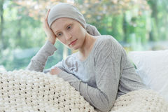 Woman worrying about her condition. Young sad woman worrying about her health condition Royalty Free Stock Photography