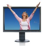Woman in worship getting out of a monitor Stock Photo