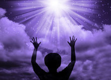 Woman worship and praise. Silhouette of a christian woman praise the lord Royalty Free Stock Photography