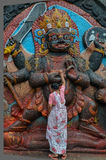 Woman Worshiping A God, Napal, Kathmandu, Durabar Square. Woman worshiping one of the hindu's gods in Nepal, Durbar Square Royalty Free Stock Photography